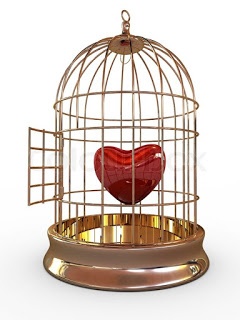 1676345-one-red-heart-in-golden-cage-isolated-on-white-background